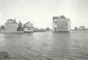 The building that would become the Dreamland being floated across Nantucket Harbor.